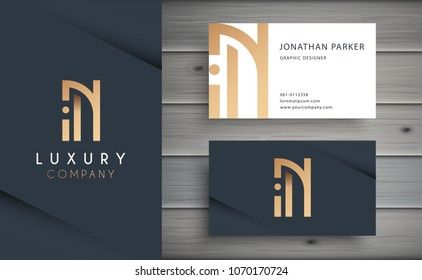 Luxury vector logotype with business card template. Premium letter N logo with golden design. Elegant corporate identity.