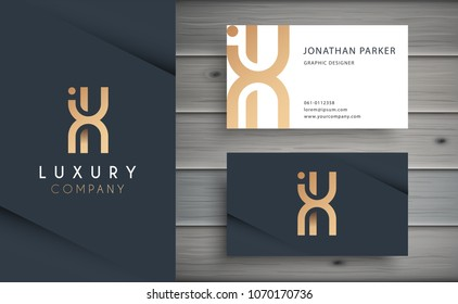 Luxury vector logotype with business card template. Premium letter X logo with golden design. Elegant corporate identity.