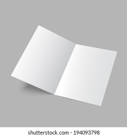 Lying  blank two fold paper brochure on gray background.