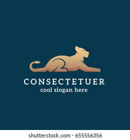 Lying Golden Lion Abstract Vector Sign, Emblem or Logo Template. Flat Style Graceful Lioness Silhouette with Typography on Dark Background.
