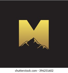 M alphabet mountain negative space letter logo gold black background