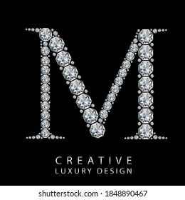 M diamond letter vector illustration. White gem symbol logo for your luxury business, casino, jewelry or web site. Upper letter with many sparkling diamonds isolated on black background.
