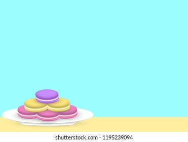 Macarons on white plate, turquoise color in the background.