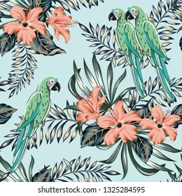 Macaw green parrots, palm leaves, pink hibiscus flowers, light blue background. Vector floral seamless pattern. Tropical illustration. Exotic plants, birds. Summer beach design. Paradise nature
