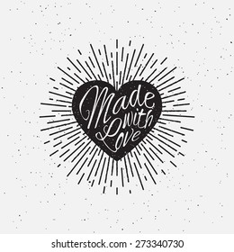 'Made with Love' vintage grunge hand lettering with heart and rays for t-shirt apparel, print, poster, card design etc. Vector Illustration.