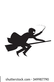 Magician silhouette on a broom stick