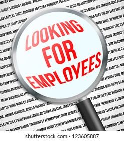 Magnifier glass over Looking for employees text in newspaper