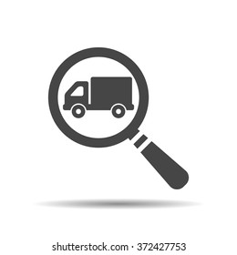 magnifying glass with a truck icon. Search truck, logistics