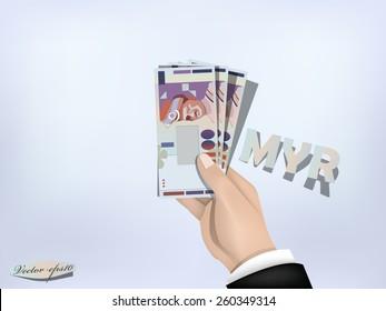 malaysian ringgit money paper on hand,cash on hand