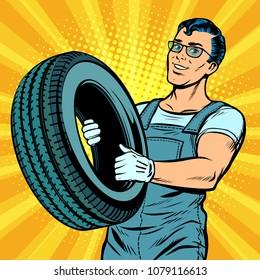 Male car mechanic with wheel. Pop art retro vector illustration comic cartoon kitsch drawing