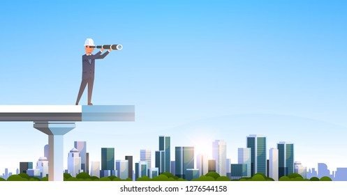 male engineer in suit and helmet looking binoculars standing unfinished bridge future strategy concept over modern city skyscraper cityscape flat horizontal