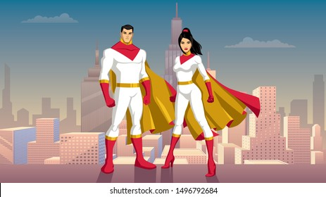 Male and female Asian superheroes posing in front of beautiful cityscape.