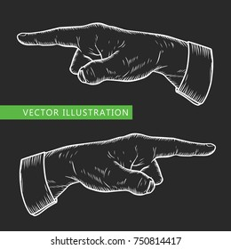 Male finger way pointer. Vector white chalk vintage engraved illustration isolated on a black background. Hand wrist sign for web design and ads