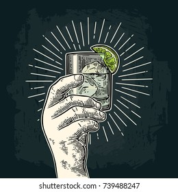 Male hand holding a glass with gin, lime and ice cubes. Vintage vector color and monochrome engraving illustration for label, poster, invitation to party. Isolated on dark background