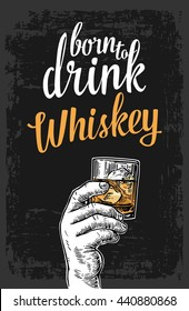 Male hand holding a glass with whiskey and ice cubes. Vintage vector engraving illustration for label, poster, invitation to party and birthday.