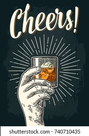 Male hand holding glass whiskey with ray. Cheers toast lettering. Vintage color and monochrome vector engraving illustration for label, poster, invitation to party. Isolated on dark background