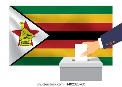 Male hand puts down a white sheet of paper with a mark as a symbol of a ballot paper against the background of the Zimbabwe flag. Zimbabwe the symbol of elections.