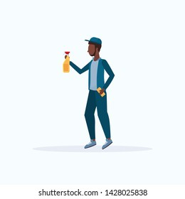 male janitor in uniform holding washcloth and spray plastic bottle african american man cleaner spraying cleaning service concept full length flat white background