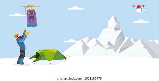 Male mountaineer ready to climb a mountain, receive a backpacks by drones in the base climbing camp.