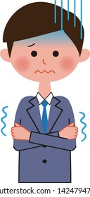 A male office worker is shivering with cold.