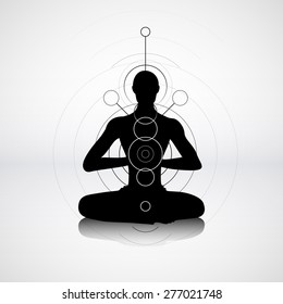 Male silhouette in yoga pose with abstract chakra symbols