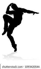 A male street dance hip hop dancer in silhouette