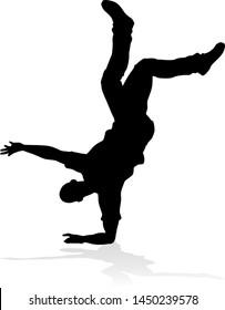 A male street dance hip hop dancer in silhouette