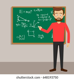 Male teacher in classroom next to blackboard with physical equations and formulas