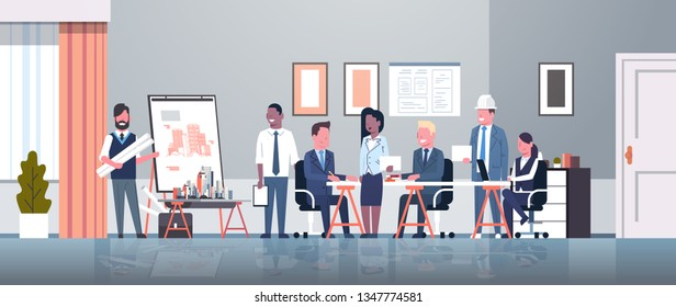 man architect showing drawing building blueprint on easel board to businesspeople engineers group panning project team meeting presentation concept horizontal full length