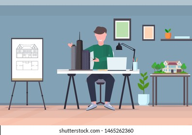 man architect using compass engineer drafting new building city model urban panning project concept housing contractor designing house plan draftsman studio interior horizontal full length