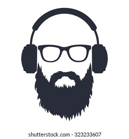 man with a beard wearing glasses and headphones