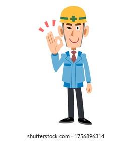A man in a blue workwear wearing a helmet giving an OK sign