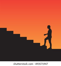 Man climbs the stairs silhouette, on the sunset background