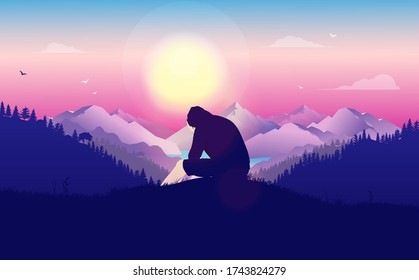 Man crying alone in landscape - Young male in hoodie sitting on hilltop with hands to his face. Beautiful landscape and view with sun in background. Unhappiness, feeling lost and outcast concept.