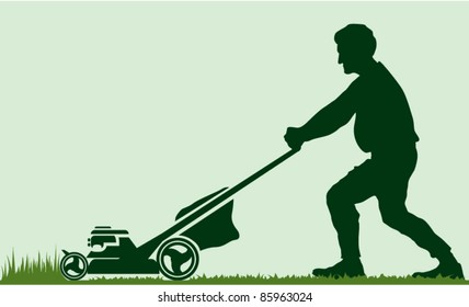 Man cutting grass with lawn mover