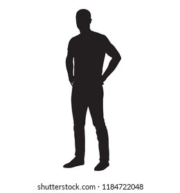 Man dressed in shirt and jeans standing with hands on hips, side view isolated vector silhouette