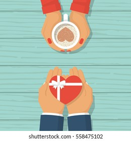 Man gives a gift on Valentine's Day. Loving couple male and woman at desk. Coffee with chocolate heart in hands of female. Gift with a ribbon in form of heart. Vector flat design. Wooden background.