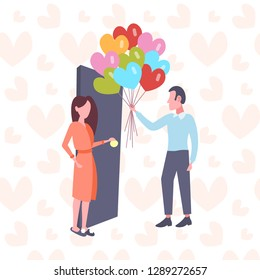 man giving woman colorful heart shape air balloons happy valentines day concept young couple in love holiday surprise girl opening door full length characters flat