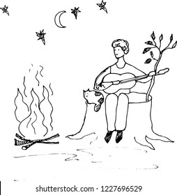 Man with guitar and cat by the fire