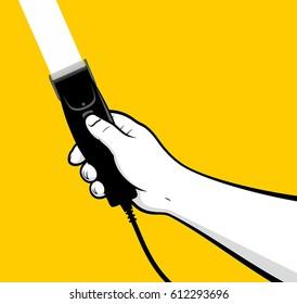 Man hand using electric hair clipper