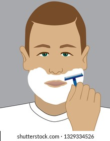 A man has lathered up with shaving cream and is preparing to shave