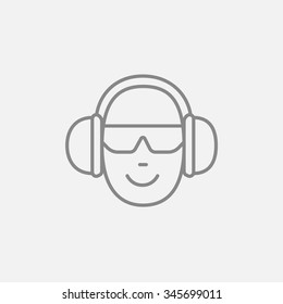 Man in headphones line icon for web, mobile and infographics. Vector dark grey icon isolated on light grey background.