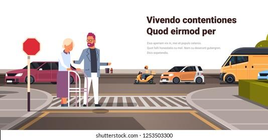 man help senior woman with walking frame crossing street urban city traffic cars on road crosswalk isolated copy space horizontal flat