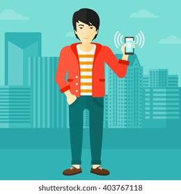 Man holding ringing telephone.