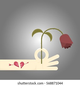 Man holding wither red rose that faded away refer to disappointment in love or fail in love. A man has broken heart tattoo on his arm.