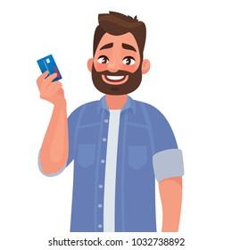Man holds a credit card in his hand. Vector illustration in cartoon style
