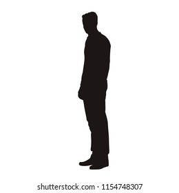 Man in jumper standing, isolated vector silhouette. Side view, people with slim body