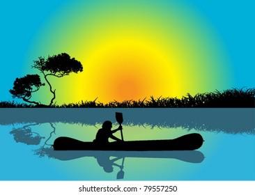 Man kayaking at sunrise