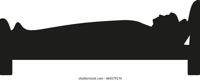 Man lying in bed and sleeping silhouette