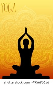 man meditates, does yoga on a gold background